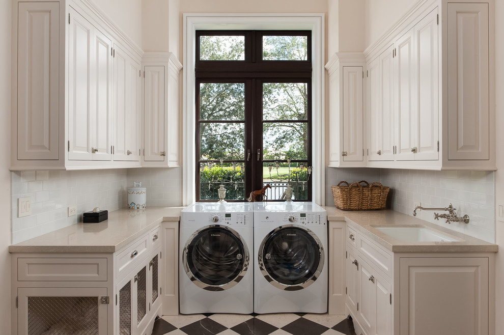 Elegant multicolored floor laundry room photo in Other with white cabinets, white walls and beige countertops