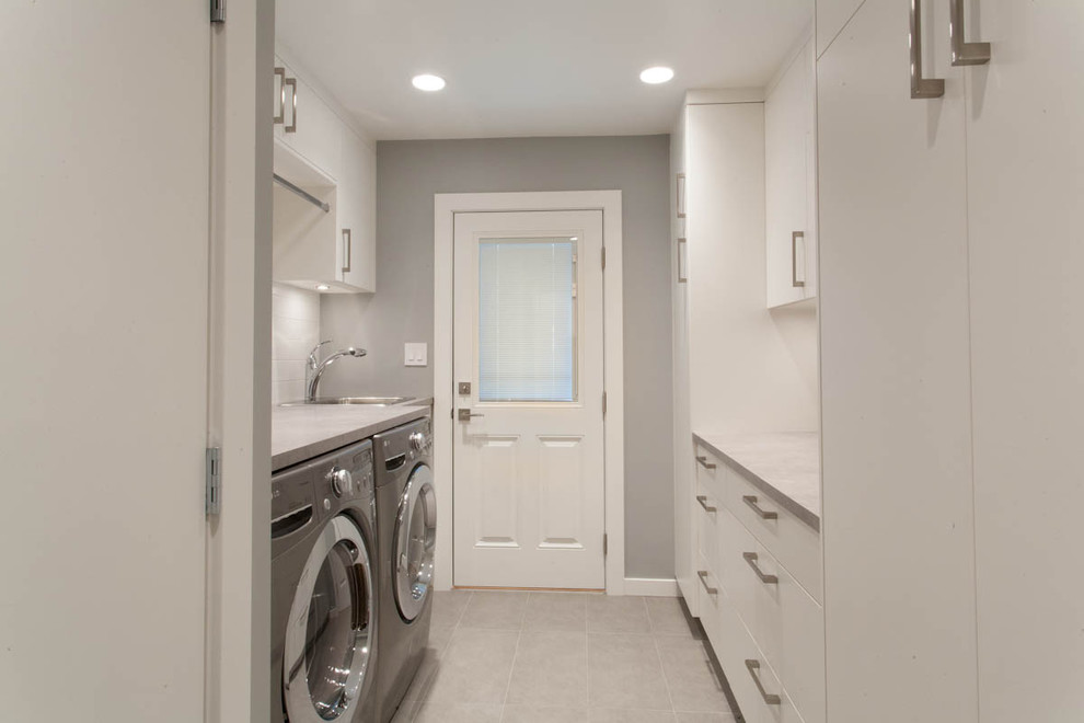 Example of a trendy laundry room design in Vancouver