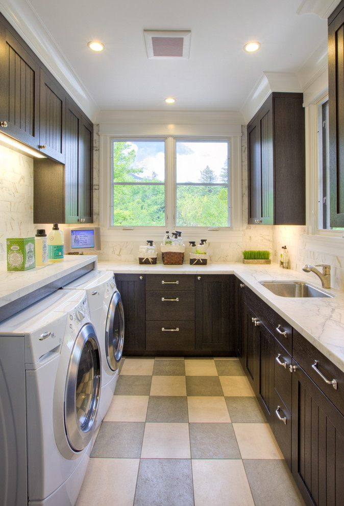 Ornate u-shaped multicolored floor dedicated laundry room photo in San Francisco with dark wood cabinets and a side-by-side washer/dryer