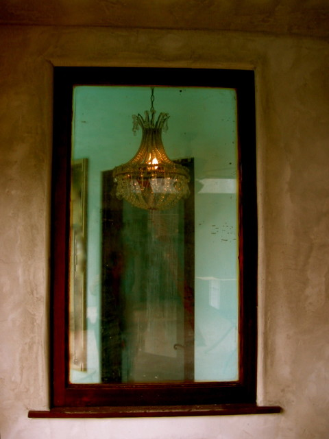 VIntage chandelier in laundry room window eclectic-laundry-room