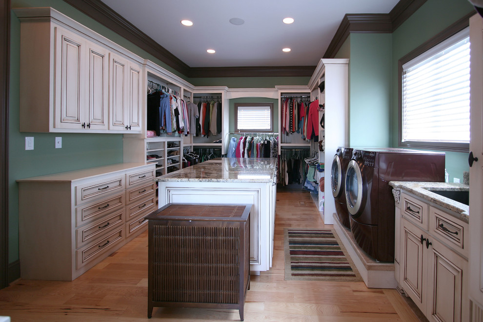 Elegant laundry room photo in Charlotte with blue walls and a side-by-side washer/dryer