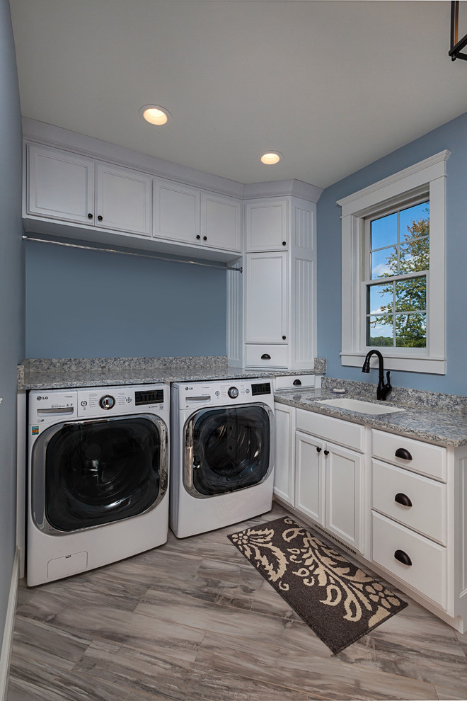 Inspiration for a mid-sized country l-shaped marble floor utility room remodel in Grand Rapids with a single-bowl sink, recessed-panel cabinets, white cabinets, granite countertops, blue walls and gray countertops