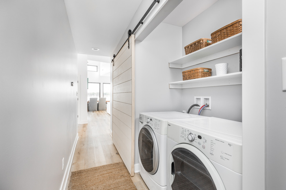Beach style single-wall light wood floor and beige floor laundry closet photo in Indianapolis with gray walls and a side-by-side washer/dryer