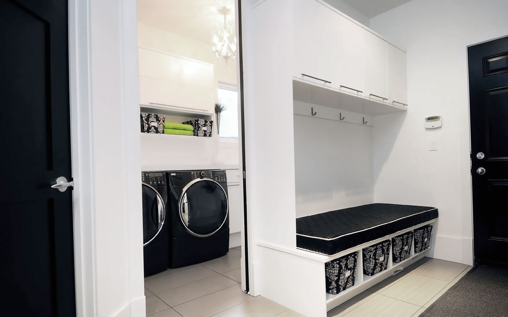 Trendy laundry room photo in Other with flat-panel cabinets, white cabinets and a side-by-side washer/dryer