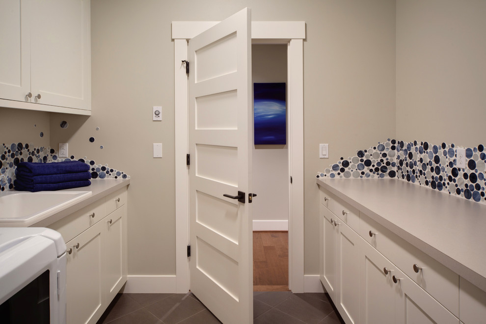 Inspiration for a transitional galley dedicated laundry room remodel in Seattle with a drop-in sink
