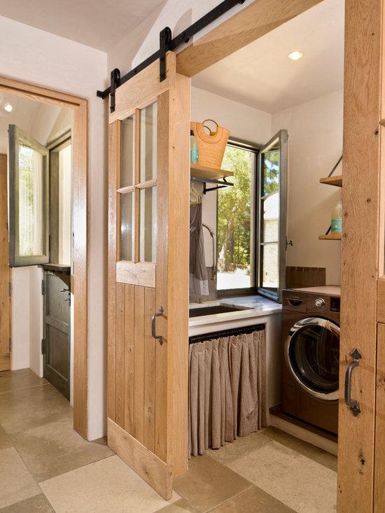 Mediterranean laundry room design ideas pictures remodel for Laundry room sliding doors