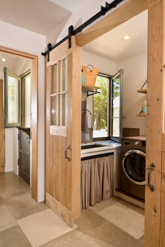 Inspiration for a mediterranean dedicated laundry room remodel in San Francisco