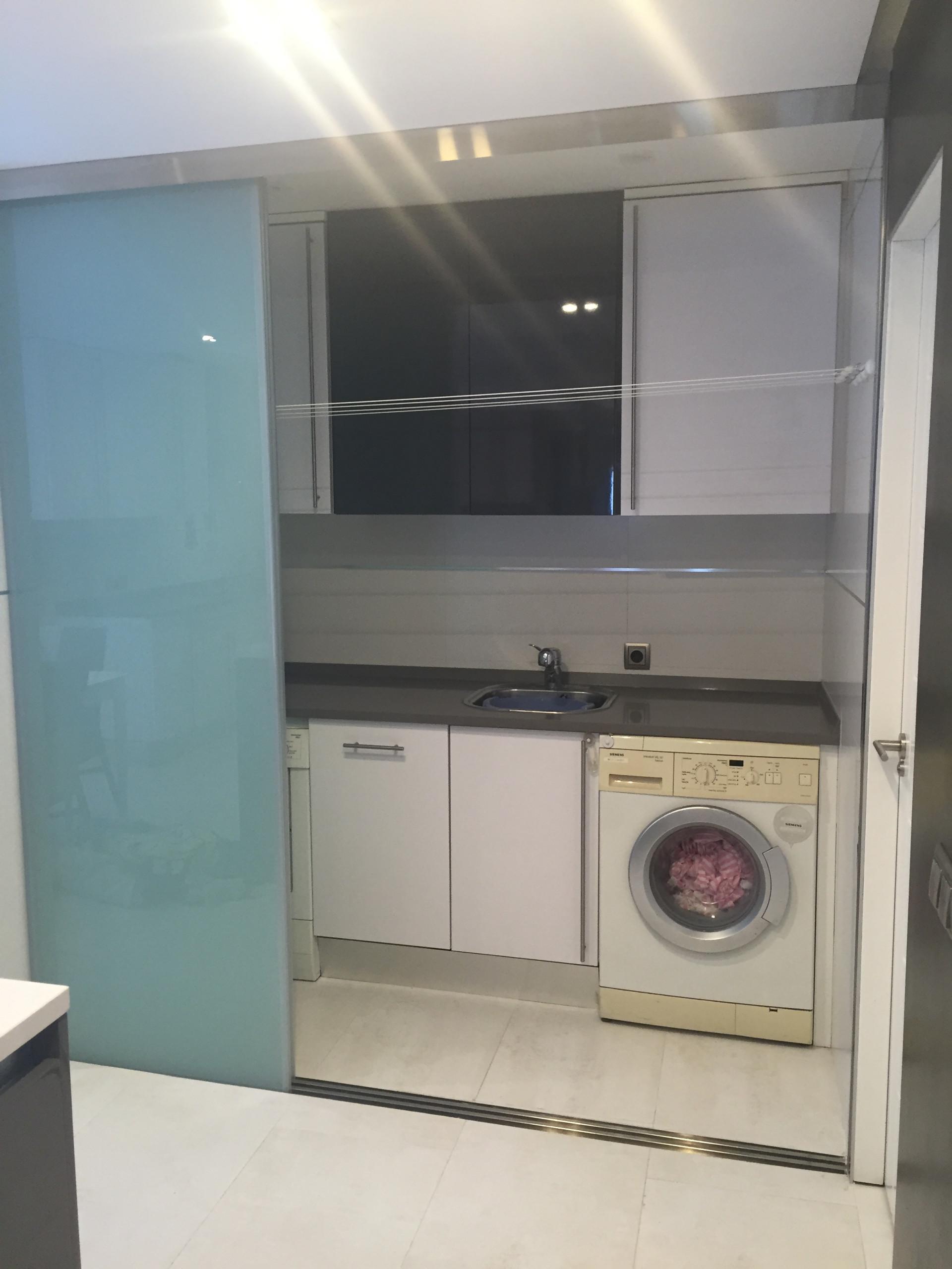 Zona lavadero oculto en cocina