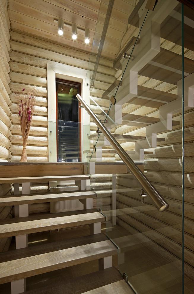 Идея дизайна: п-образная лестница в современном стиле с деревянными ступенями без подступенок