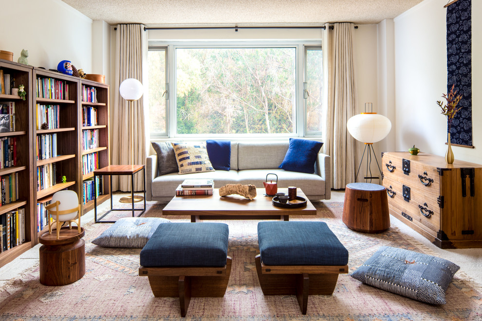 Small trendy enclosed carpeted and beige floor living room library photo in San Francisco with no tv, white walls and no fireplace