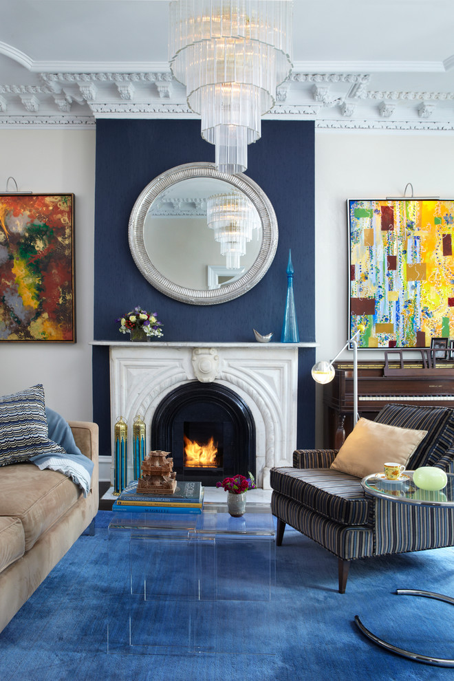 Living room - contemporary living room idea in New York with blue walls and a standard fireplace