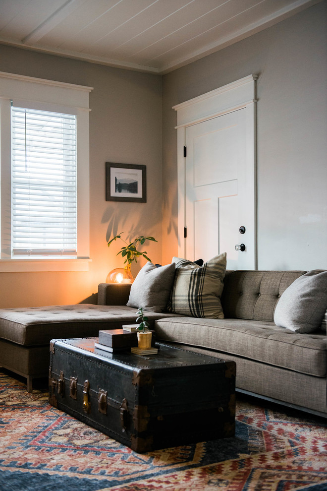 Example of a small eclectic dark wood floor living room design in New York with gray walls, a standard fireplace, a brick fireplace and a wall-mounted tv