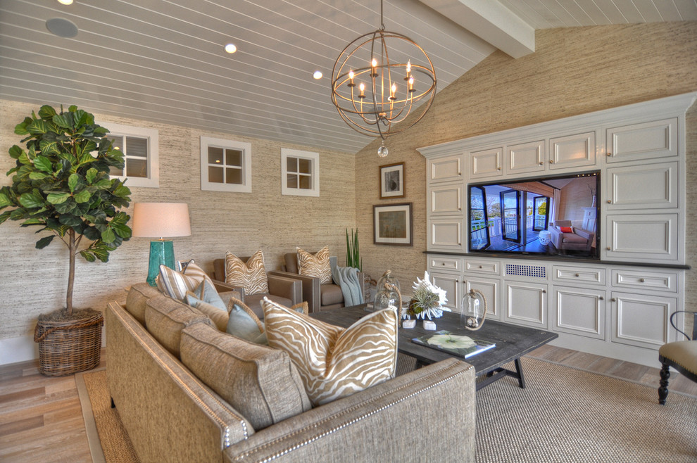 Inspiration for a large coastal living room remodel in Los Angeles with beige walls and a media wall