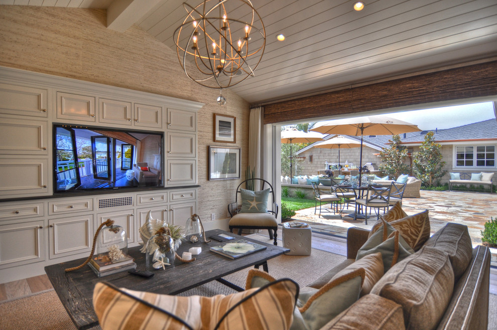 Inspiration for a coastal living room remodel in Los Angeles with beige walls and a media wall