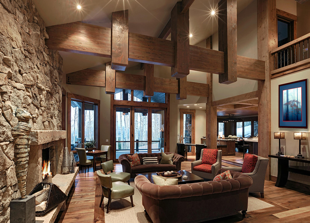 Inspiration for a rustic living room remodel in Salt Lake City with a standard fireplace and a stone fireplace