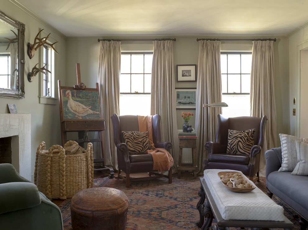 Inspiration for a cottage formal and enclosed living room remodel in New York with gray walls, a standard fireplace and a plaster fireplace