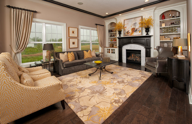 Example of a large classic formal and open concept medium tone wood floor living room design in Columbus with gray walls, a standard fireplace, a stone fireplace and no tv