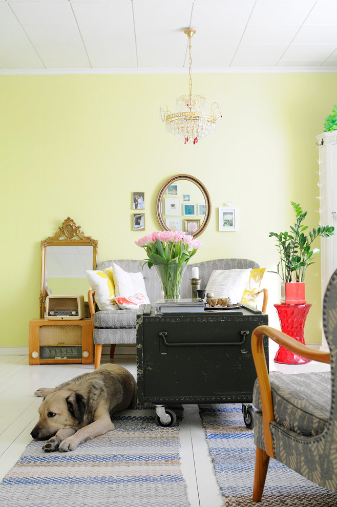 Eclectic painted wood floor living room photo in Other with yellow walls