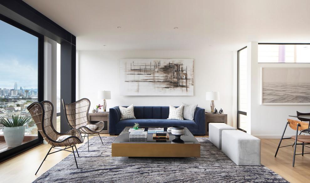 Trendy open concept light wood floor and beige floor living room photo in San Francisco with white walls