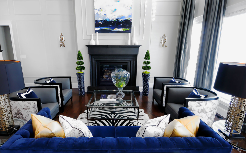 Example of a trendy dark wood floor and brown floor living room design in Other with white walls and a standard fireplace