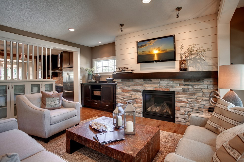 Living room - rustic open concept living room idea in Minneapolis with a standard fireplace