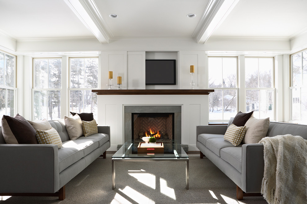 Trendy living room photo in Minneapolis with a concealed tv