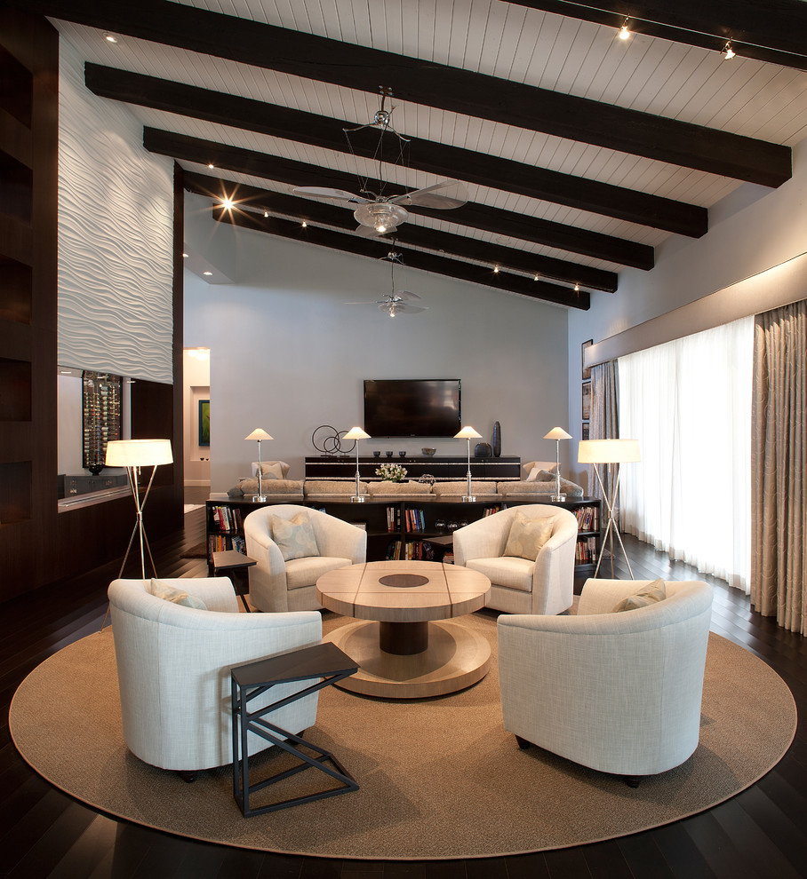 Example of a large trendy open concept dark wood floor living room design in Phoenix with gray walls, a wall-mounted tv and a bar