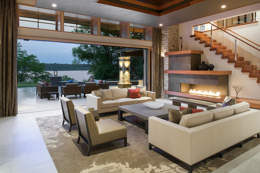 Huge trendy open concept and formal porcelain tile living room photo in Minneapolis with a ribbon fireplace, a stone fireplace and white walls