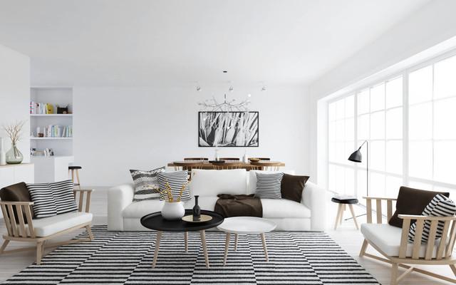 Diseño de salón escandinavo con paredes blancas, suelo de madera clara y suelo beige