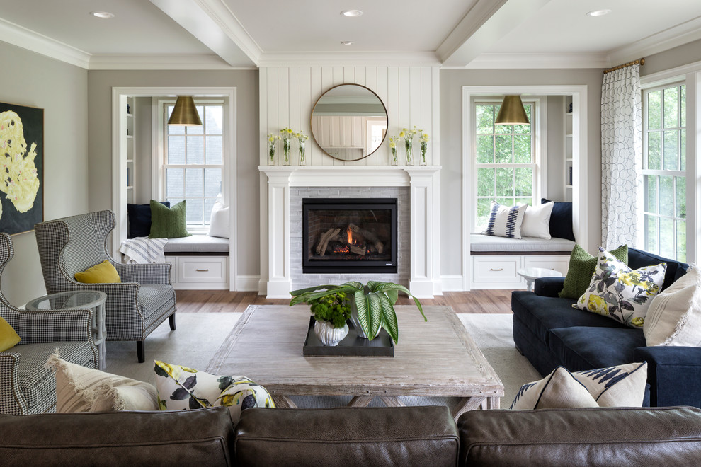 Inspiration for a coastal formal light wood floor living room remodel in Minneapolis with gray walls, a standard fireplace and a tile fireplace