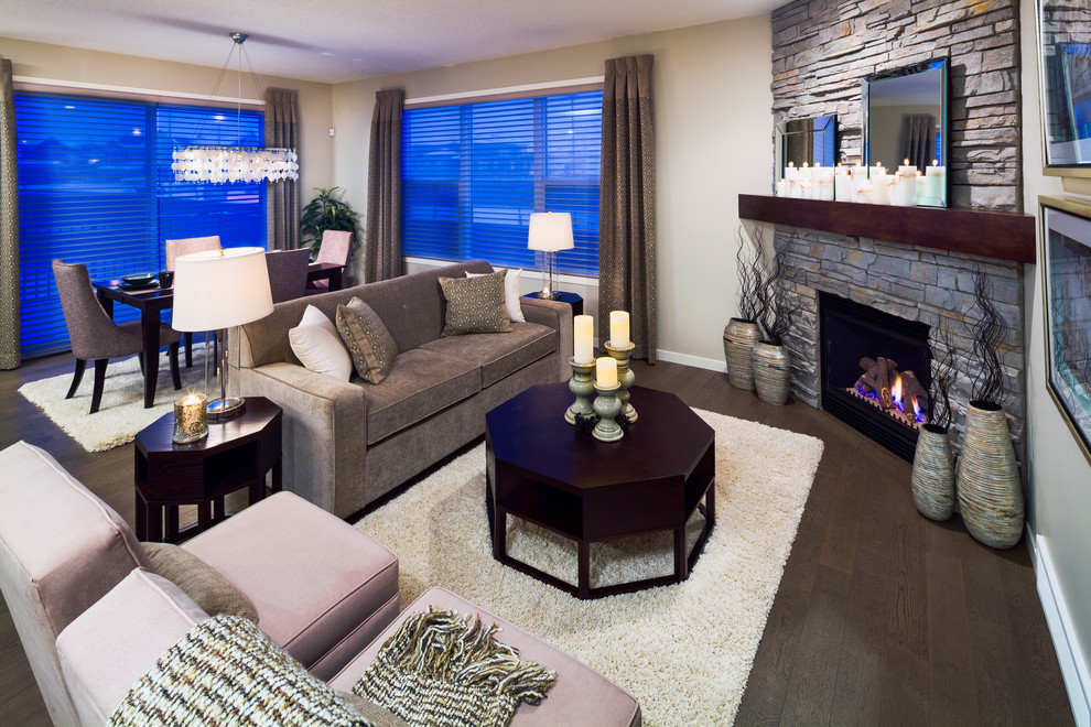 Trendy living room photo in Calgary with beige walls and a corner fireplace