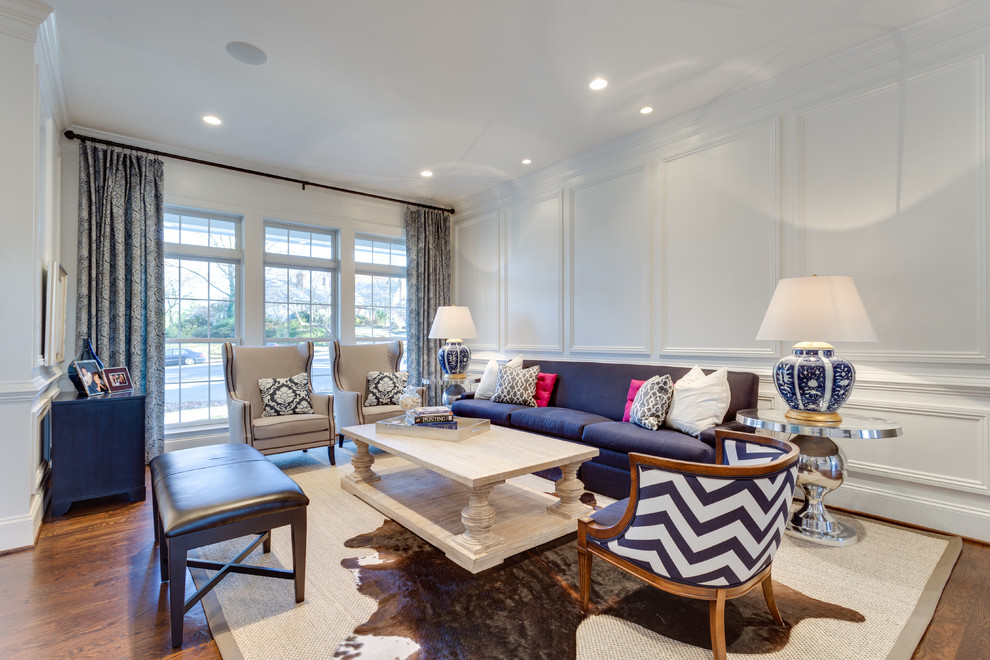 Living room - transitional formal and enclosed medium tone wood floor living room idea in DC Metro with white walls