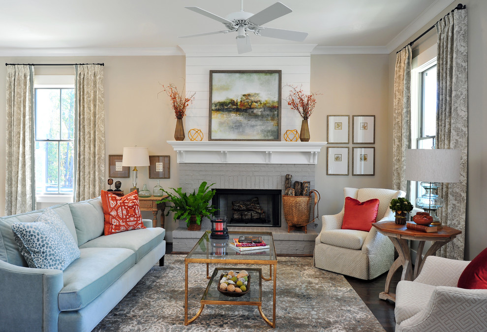 Inspiration for a mid-sized transitional open concept medium tone wood floor living room remodel in Atlanta with beige walls, a standard fireplace and a brick fireplace