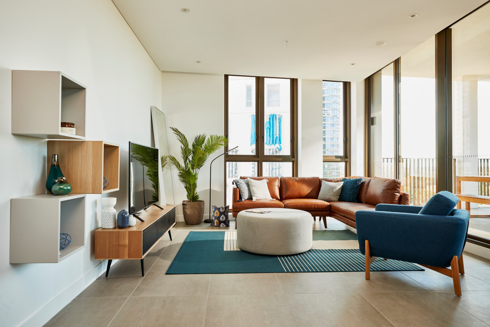 Living room - large contemporary open concept gray floor living room idea in Sydney with white walls and a tv stand