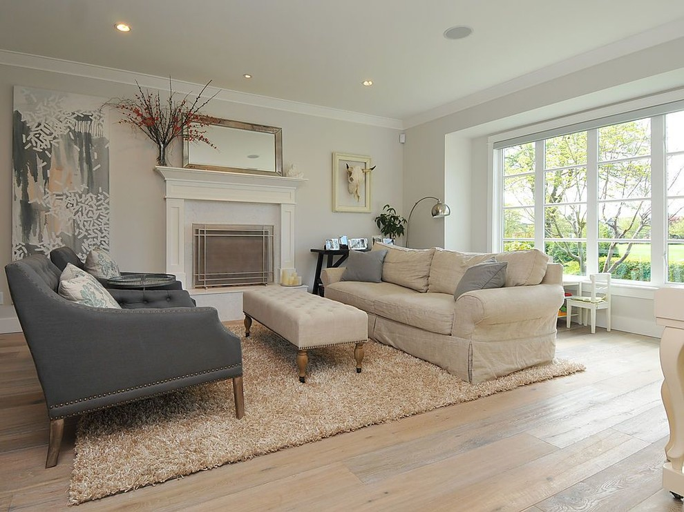 Elegant light wood floor living room photo in Vancouver with gray walls and a standard fireplace