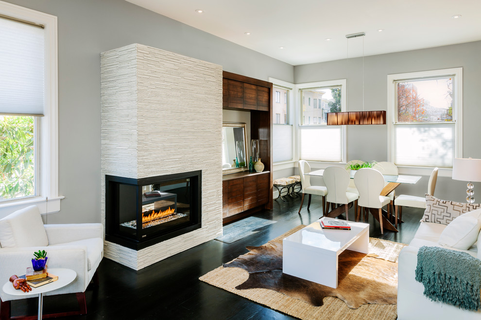 Living room - contemporary formal and open concept dark wood floor and black floor living room idea in San Francisco with a two-sided fireplace, gray walls, a tile fireplace and a media wall