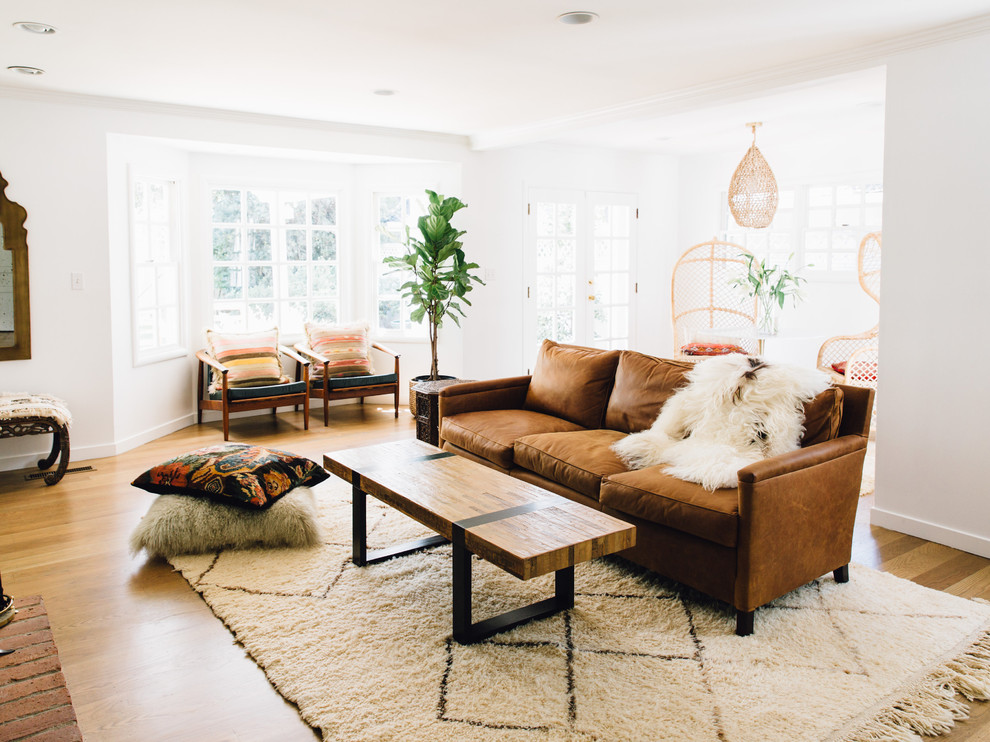 Living room - scandinavian medium tone wood floor living room idea in Sacramento with white walls and no fireplace