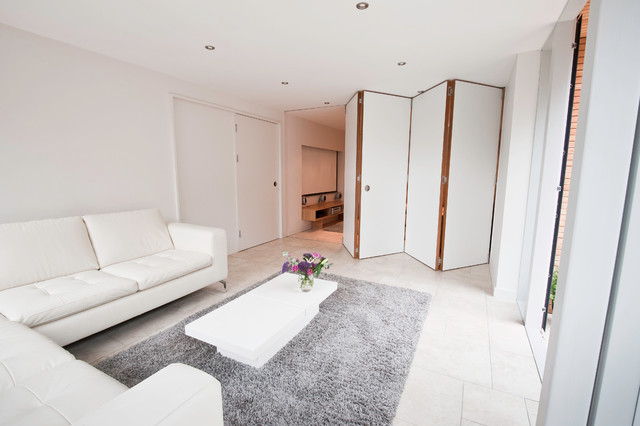 dividing doors living room. Trendy living room photo in Other with white walls Dividing Door  Houzz