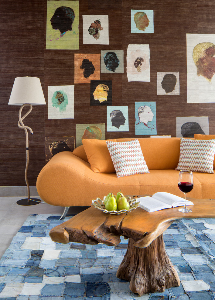 Example of a trendy concrete floor living room design in Miami with brown walls