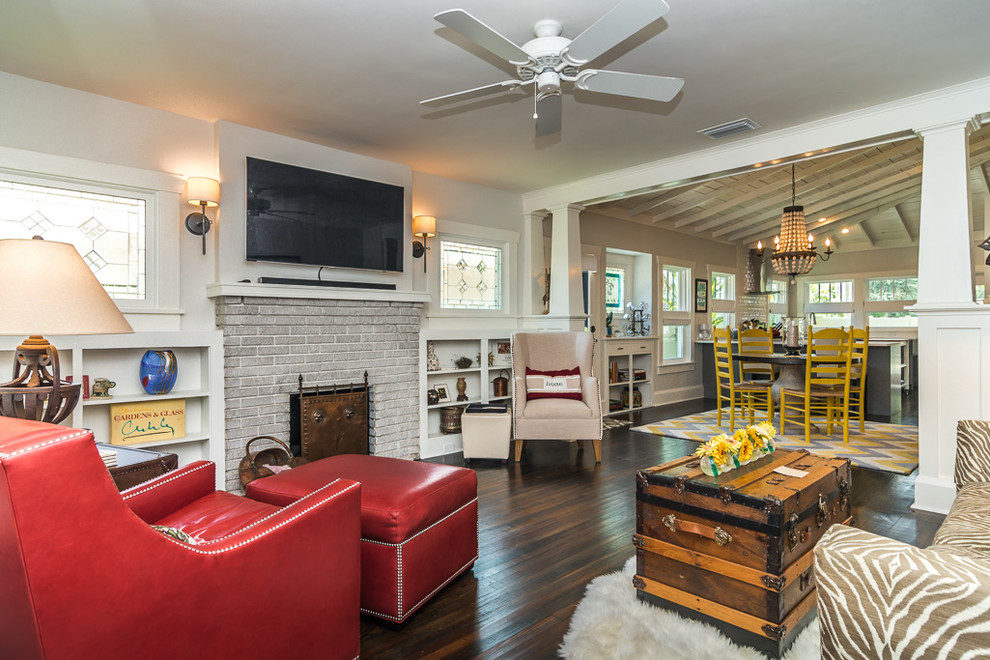 Living room - traditional dark wood floor living room idea in Tampa with white walls, a standard fireplace and a brick fireplace