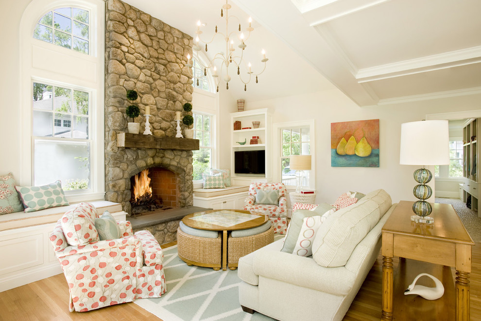 Living room - large traditional open concept medium tone wood floor living room idea in Boston with a stone fireplace, beige walls, a standard fireplace and a media wall
