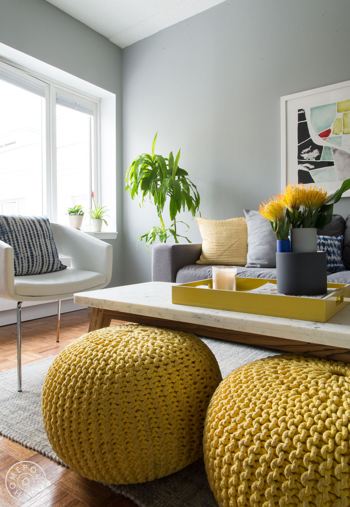 Living room - mid-sized modern open concept medium tone wood floor living room idea in New York with gray walls and a wall-mounted tv