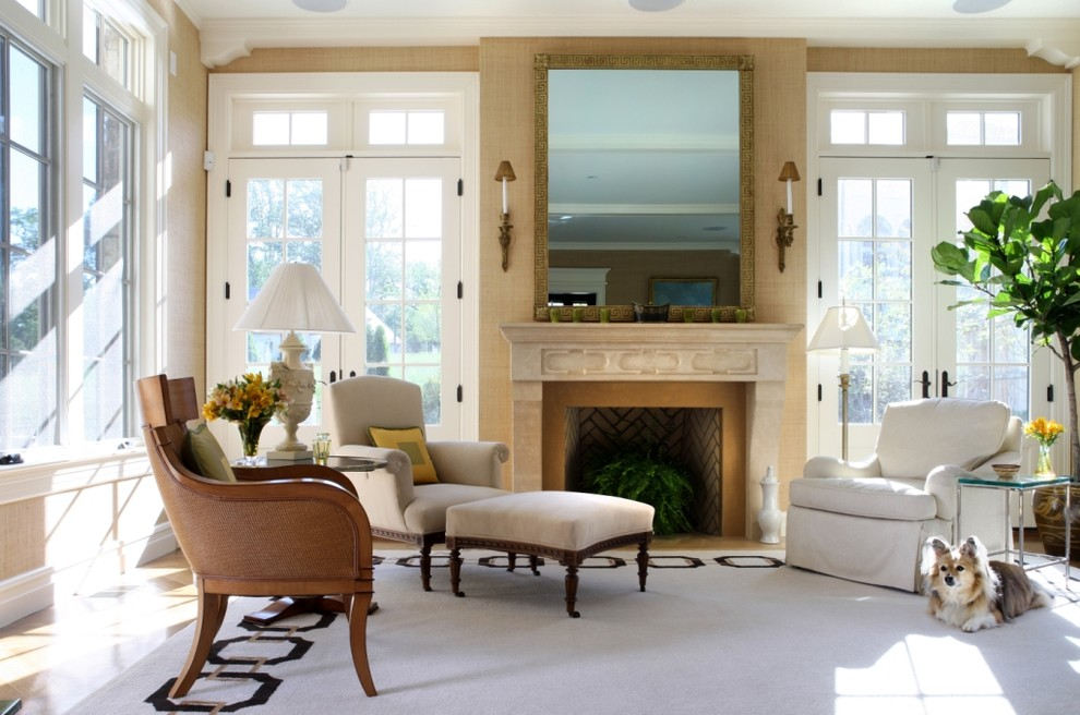 Example of a trendy living room design in DC Metro with beige walls and a standard fireplace