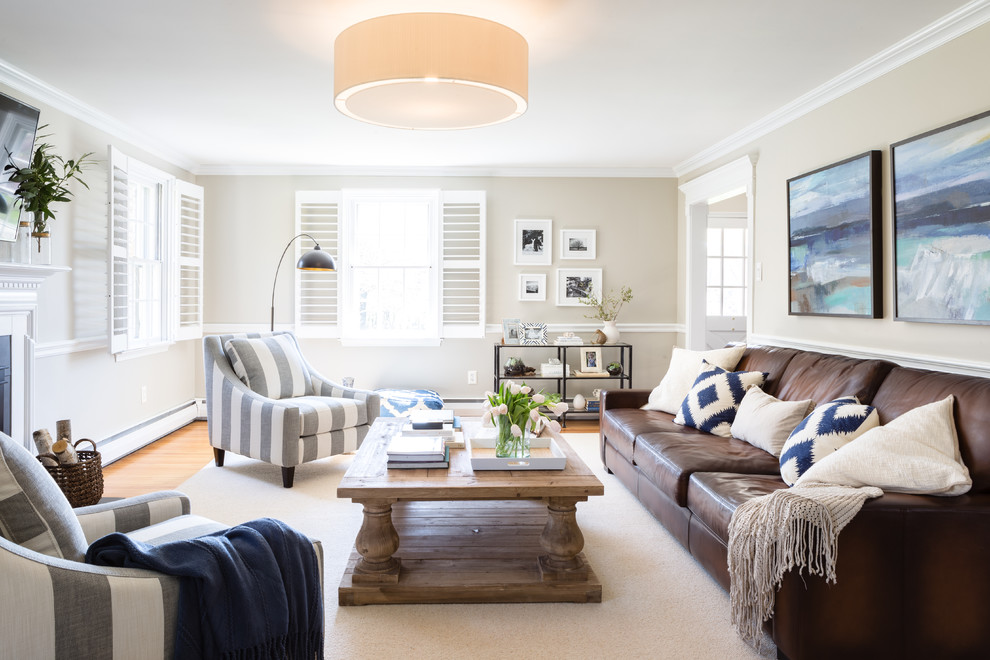 Example of a large transitional enclosed light wood floor living room design in Philadelphia with gray walls and a standard fireplace