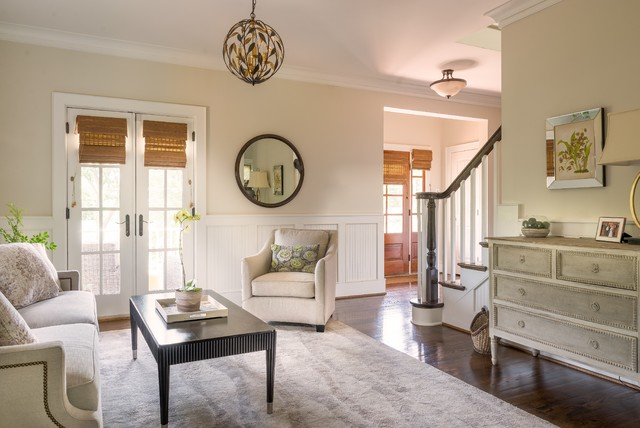 Living room - mid-sized transitional open concept medium tone wood floor living room idea in New York with beige walls