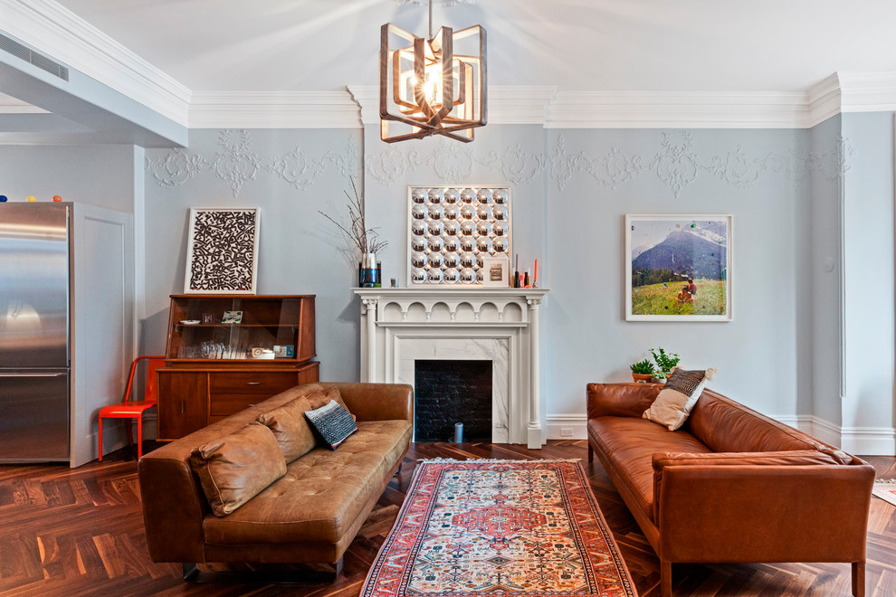Inspiration for an eclectic formal and open concept dark wood floor and brown floor living room remodel in New York with blue walls, a standard fireplace, a stone fireplace and no tv