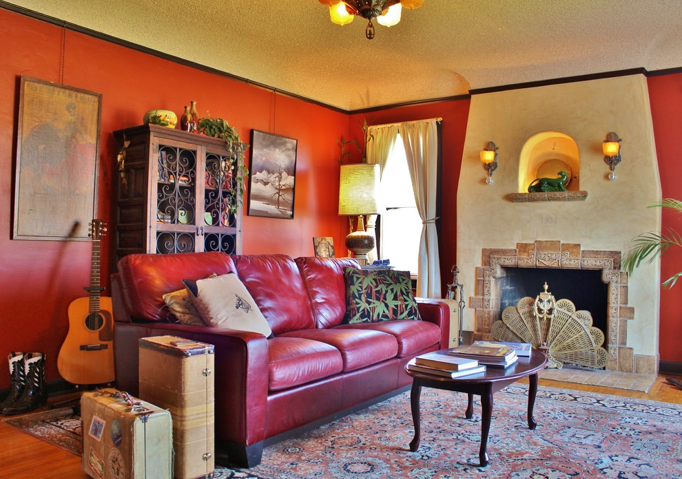 Inspiration for an eclectic enclosed living room remodel in Seattle with red walls, a standard fireplace and a tile fireplace