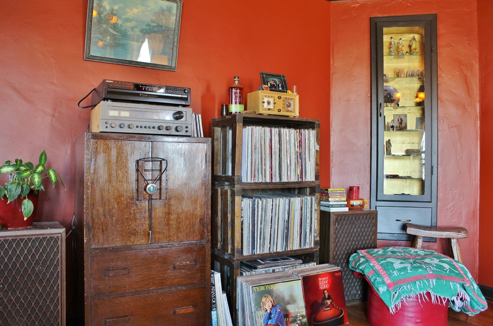 Example of an eclectic enclosed living room design in Seattle with red walls, a standard fireplace and a tile fireplace