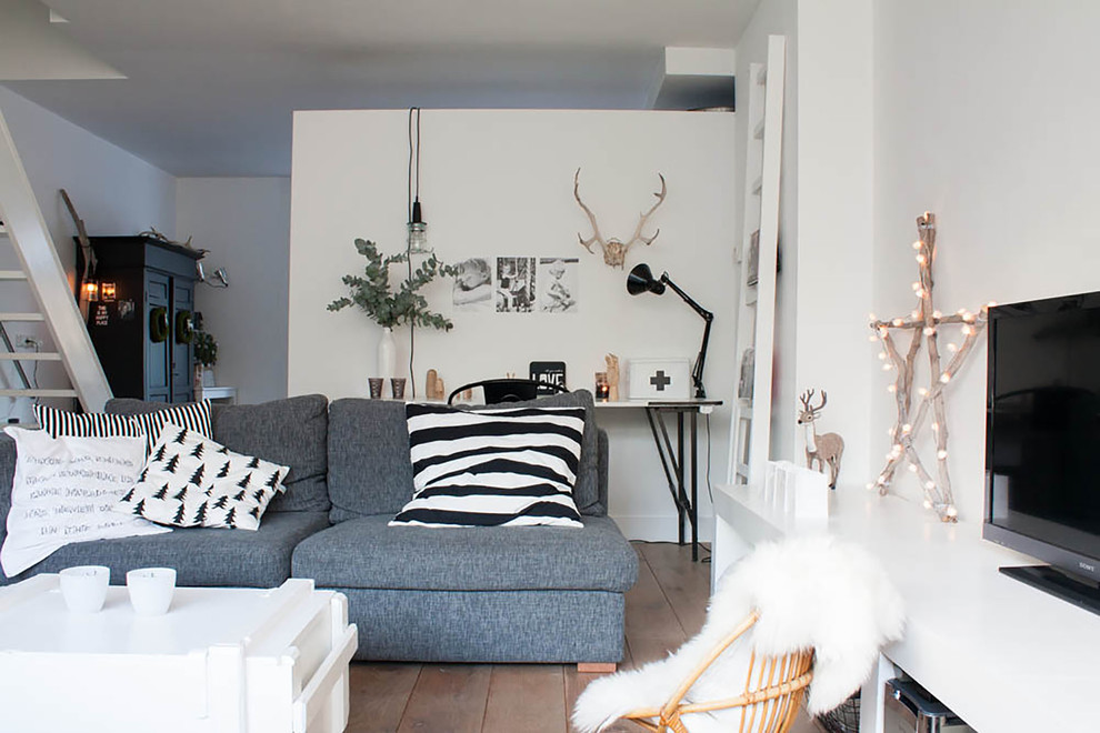 Eclectic living room photo in Amsterdam with white walls and a tv stand