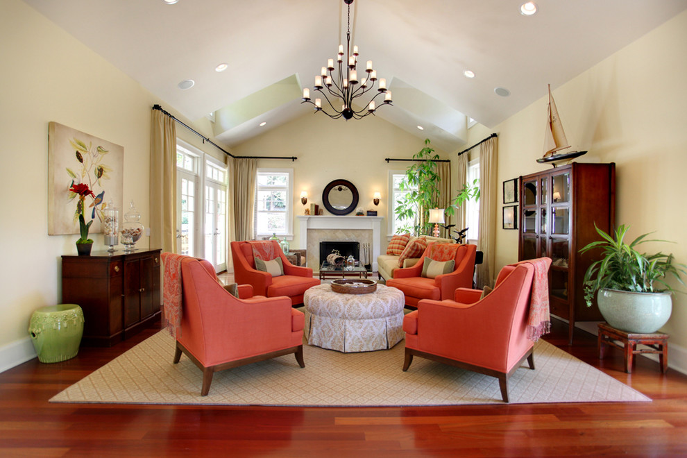 Example of a large classic living room design in Los Angeles with beige walls and a standard fireplace